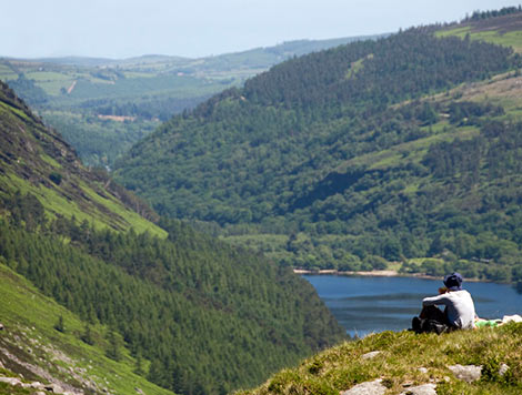 person sitting with view of Glendalough lake